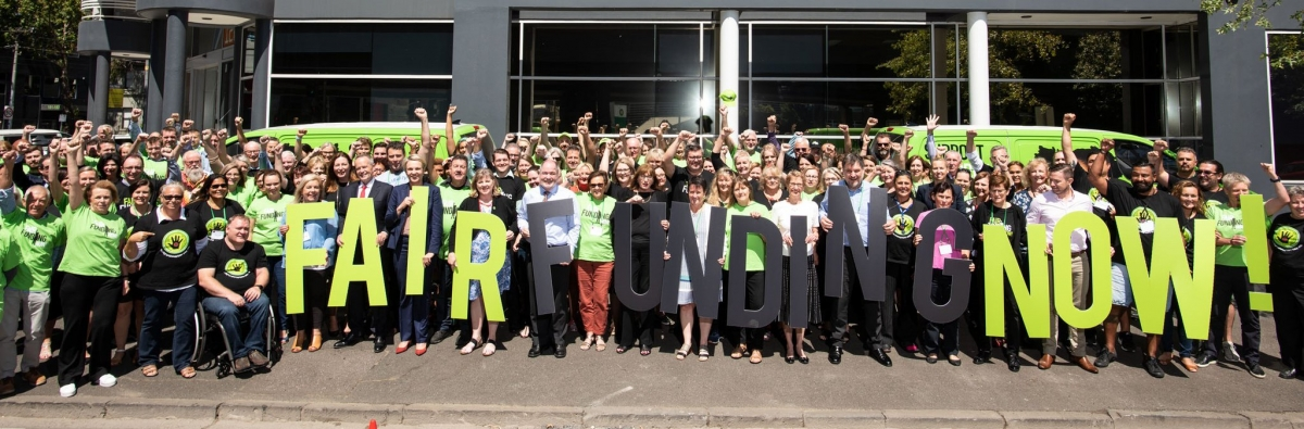 """AEU state, territory and Federal leaders campaigning  for Fair Funding Now! for public schools. Labor party's Leader Bill Shorten is holding the A, and Labor's spokesperson for Education Tanya Plibersek is holding the I in """"FAIR'."""